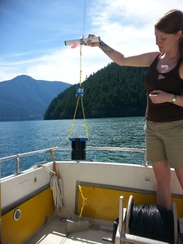 Lena holds up the instrument package on the boat deck displaying the stacking order
